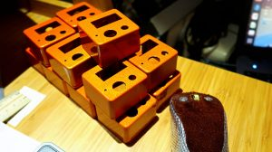 15 metallic-flake, color-shifting orange pedal cases ready for engraving!